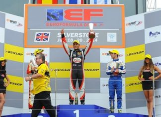 Sandy Stuvik (center) celebrates on the podium after double success at Silverstone.