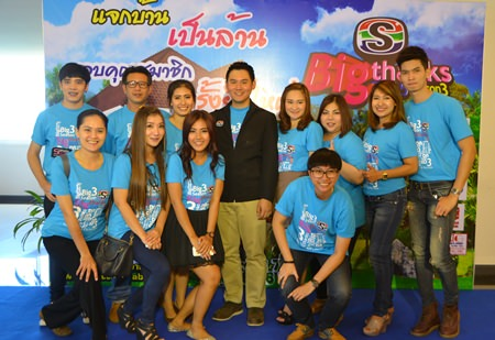 Rattakit Hengtrakul, Deputy Managing Director of Sophon Cable T.V. Co. Ltd. (center left), poses with Sophon staff members at Hotel J during an event held Aug. 11 to announce the company's 3.3 million baht customer 'thank you' promotion.
