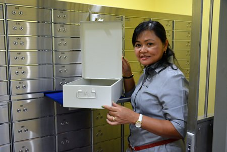 Suthamma Mio Thana, General Manager of Pattaya Self Storage, displays one of the safety deposit boxes.