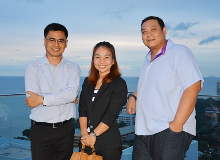 From Cape Dara Resort, Sittidej Rochanavibhata, the General Manager, Nipaporn Phesatcha, Executive Catering, and Tanin Suphavittayakorn, the Executive Assistant Manager pose for a photo on the rooftop of the Executive Tower, Holiday Inn Pattaya.