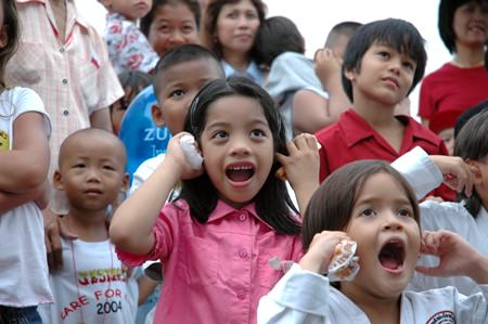 Children watch the stage entertainment at last year's event.