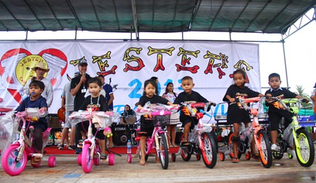 The Fountain of Life 'best of class' children receive their bicycles during last year's event.