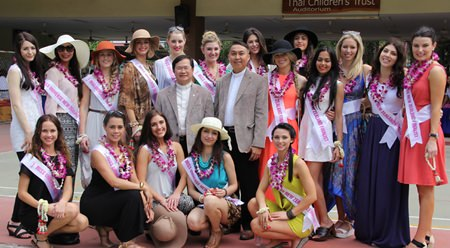 Father Michael and Father Peter, from the Father Ray Foundation, pose with the beauty queens.