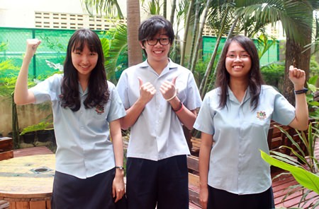 Year 11 star students celebrate (from left) Hui Eun was awarded A* in an amazing seven subjects, Jason did brilliantly well with his IGCSE results and Perfect Pauline gained 9 IGCSEs.