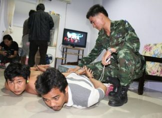 Police and military officials raided another suspected loan shark house in East Pattaya.