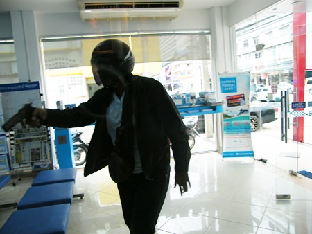It takes a disguised police officer only 15 seconds to steal 200,000 baht at gunpoint from Krung Thai Bank's Thepprasit Road branch.