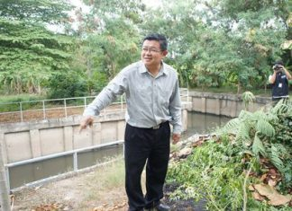 Deputy Mayor Verawat Khakhay leads city engineers to inspect the Naklua canal near the Jake Houy football stadium.