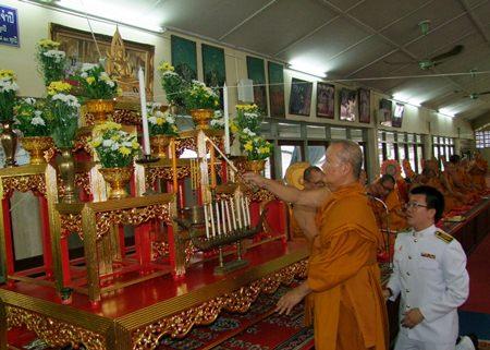 A senior monk at Wat Nok lights candles to commemorate HRH Crown Prince Maha Vajiralongkorn's birthday July 28.