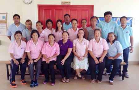ISC staff gathers for a team photo with staff from the Hand to Hand Foundation.