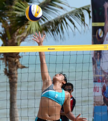 Rising high, a player stretches for the ball in the female third place playoff game.