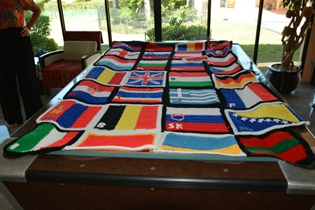 Lesley knitted and crocheted a bed cover made up of all the flags of all the countries that they passed through. Most of the flags were made in the country that the flag represents.