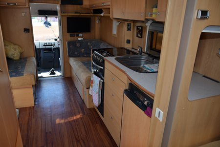 The renovation began with their purchase of an accident-damaged German motor home, which they stripped of its interior to furnish Plodd.