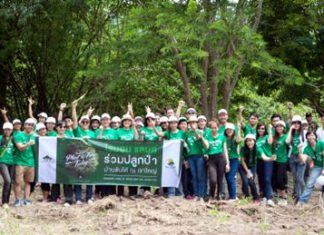 Raimon Land employees led by Nuch Kalyawongsa, Director and Chief Financial Officer, pose at Baan Sap Tai while taking part in a joint reforestation project with the Plant A Tree Today Foundation (PATT).