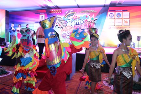 Dancers and ghosts perform a traditional Thai - Isaan dance for the opening of the Pattaya Bartender Isaan Classic 2014.