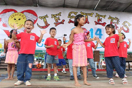 Young performers from the Mercy Center sing and dance to entertain the crowd during the early stages of this year's Jester's Care for Kids Children's Fair, which was heralded as the biggest ever.  Fun, games, prizes, entertainment - you name it, it was being enjoyed on Sunday, Sept. 7 at the Regents School Pattaya.