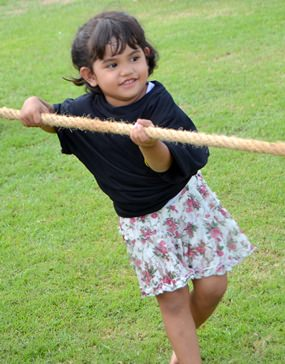 3-year-old Baan does her best in the tug-o-war competition - and does it without losing her cute smile.