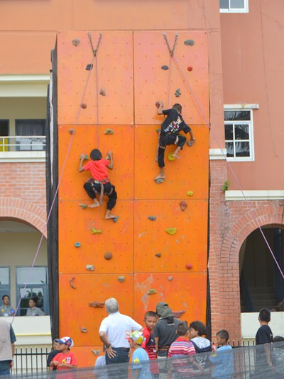 The climbing wall allows kids to show their climbing skills.