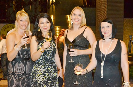 Elegant ladies add glamour to the gala event.