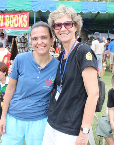 Hand 2 Hand Foundation's Margie Grainger with Jesters Care for Kids' school coordinator Linden Phanpho.
