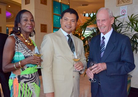Natthachai Chaiprom (center) poses for a photo with Richard Smith and his wife Janet.