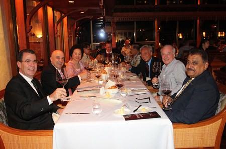 Hosts table, with Antonello Passa, GM of Royal Cliff Beach Resort Pattaya; Shahin Shahabi, vintner at Stonehedge Winery; Panga Vathanakul, Managing Director of the Royal Cliff Beach Resort Pattaya; Pol. Gen. Narongvith Thaitong; Dr. Iain Corness; and Pratheep Malhotra, Managing Director of the Pattaya Mail Media Group enjoying their food and wine.