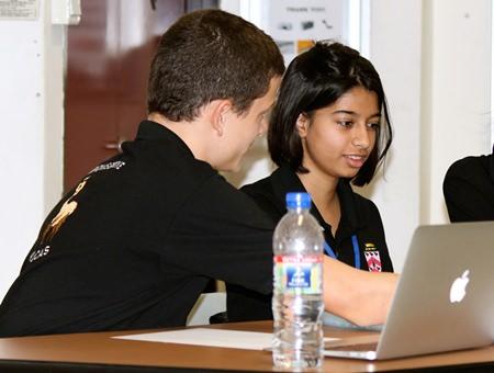 Top students Thomas Savage and Surabhi Vanalia preparing for a debate.