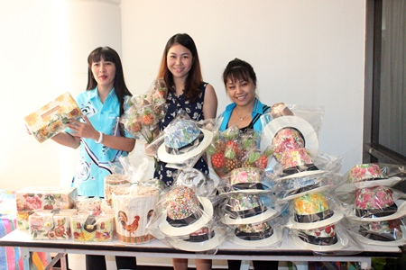 Members of the Pattaya Women's Development Group show off some of the items they will teach local women to produce to help boost their family income.