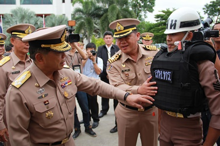 Top Navy officers inspect the bullet proof floatation vests.