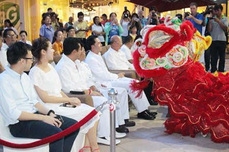 Officials announcing the schedule for this year's Vegetarian Festival are visited by a friendly lion.
