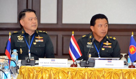 Strategic Studies Centre director Pol. Maj. Chaianand Jankhananurak (right), chaired the event, shown here seated with Pol. Col. Apicsak Sombatcharoennon.