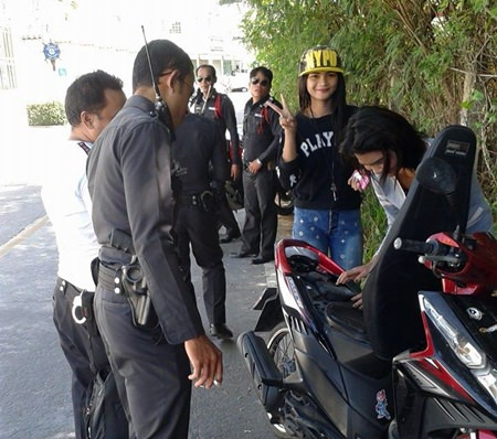 Traffic Police set up a roadblock along Soi Yume, focusing on motorcycle licenses and helmets.
