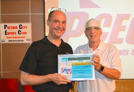 PCEC Master of Ceremonies Richard Silverberg presents Harry with a Certificate of Appreciation for his informative presentation to the Club.