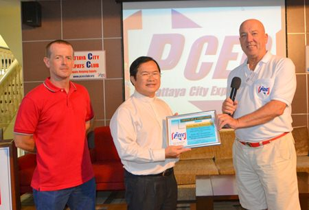 PCEC Chairman Roy Albiston presents a certificate of appreciation for the presentation about the Father Ray Foundation to Father Mike as Foundation staff member Derek Franklin looks on.