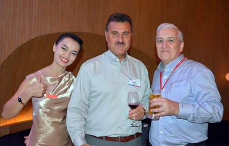 Michael Diamente (center) and David R. Nardone poses for a photo with Hilton Hotel waitress Lilly (thumbs up).