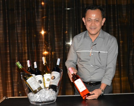 Teera Weerawan, National Sales Manager of Independent Wine & Spirit, displays a bottle of wine.