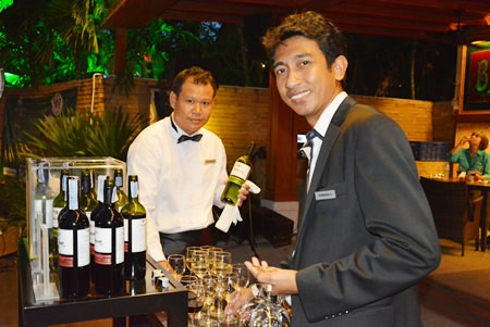 "One of the staff asks, ""Would you like a glass of red or white sir?"""