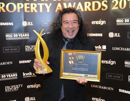 Dennis Dila is all smiles as he accepts the award for Best Landscape Architectural Design on behalf of Silverlake Vineyard & Winery.