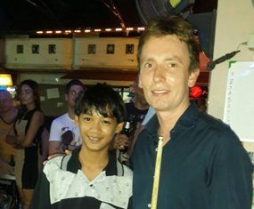 Ice Thiputhai-McArdle (left) played pool against former World Champion snooker player Ken Doherty (right) in a fundraiser at the Pattaya Orphanage for the Father Ray Foundation and beat him one up.