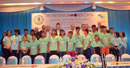 Organizers, players and benefactors gather for a group photo during the press conference announcing next year's Pattaya Snooker Open at the Amari Orchid Resort & Tower to benefit the Father Ray Foundation.