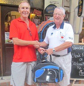 Dick Warberg (right) presents the MBMG golfer of the month award to Doug Maiko.