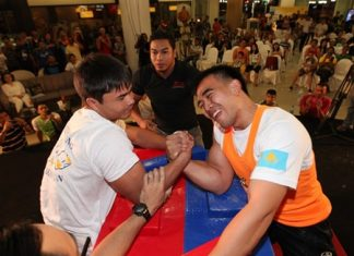 Magzhan Shamyiev defeats Thailand's Suthiwas Kohsamut for the under 75 kg. crown in this year's Pattaya International Arm Wrestling Championship. Shamyiev was one of three Kazakhstani brothers who won all 3 divisions.