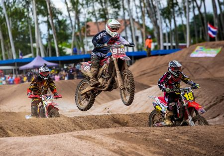 Motocross racers in the national MX 2 Open category kick up the dirt and take to the air.
