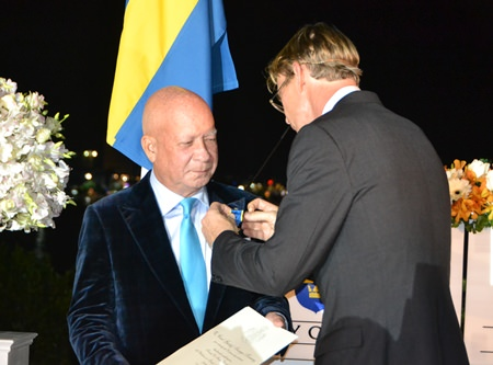 His Excellency Klas Molin bestows the Order of the Polar Star on Dr Sunya.