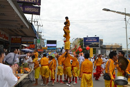 Chinese acrobats, always an exciting edition to the festival, perform on Beach Road.