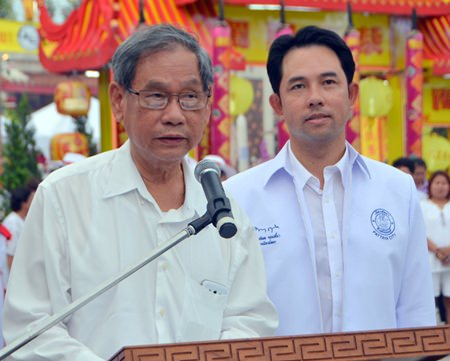 Visit Chaowalitnittithum, president of Sawang Boriboon Thammasathan, and Mayor Itthiphol Kunplome welcome people to the official opening of this year's Pattaya Vegetarian Festival.