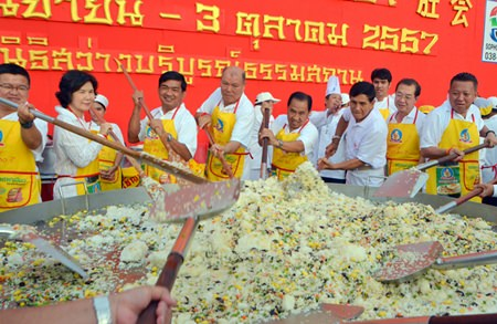 Honored guests stir the Khao Thip 5 Mongkol (Five Auspicious Celestial Rice) to serve the 5000 people attending the opening of this year's Pattaya Vegetarian Festival.