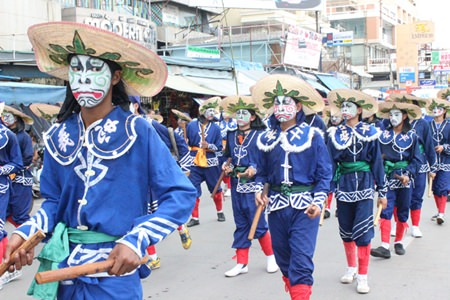 Eng-Ko fighters join the parade through town before showing off their fighting skills.