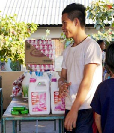 Giving out hygiene supplies to the students at Hway Ka Loke Boarding House.