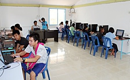 Students using the new computer room funded through Regents Gold Fish Program.