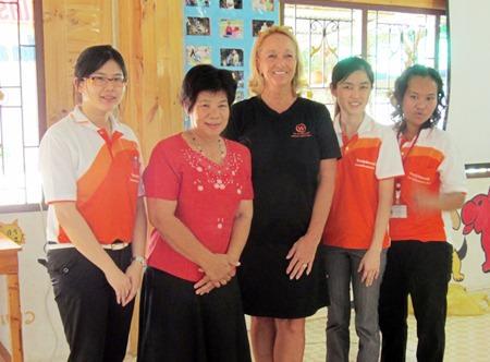 Khru Boon Choo and Rosanne Diamente with trainers from Sattahip Hospital training staff at the Baan Khun Boon Choo.